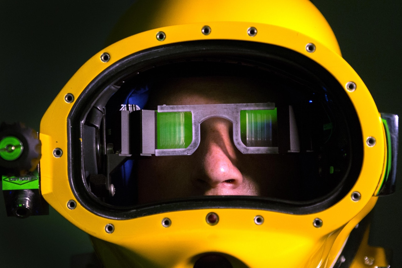 A Marine wears a prototype dive helmet with the Diver Augmented Vision Display at the Naval Surface Warfare Center Panama City Division, Naval Support Activity Panama City in Panama City, Fla., July 14, 2016. DoD photo by EJ Hersom
