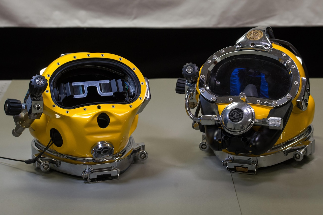 A prototype dive helmet with the Diver Augmented Vision Display, left, provides a comparison view to an unmodified dive helmet at the Naval Surface Warfare Center Panama City Division at the Naval Support Activity Panama City in Panama City, Fla., July 15, 2016. DoD photo by EJ Hersom