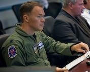 Air Force Lt. Col. Chris Power, the deputy division chief of North American Aerospace Defense Command operations support, takes part in the Amalgam Eagle 16 tactical exercise between the United States and Mexico, in Colorado Springs, Colo., July 27, 2016. The three-day exercise was aimed at strengthening information sharing and cooperation in response to a simulation of an illicit cross-border flight. DoD photo by Lisa Ferdinando