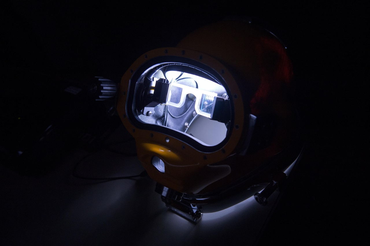 A light illuminates a prototype dive helmet with the Diver Augmented Vision Display at the Naval Surface Warfare Center Panama City Division at the Naval Support Activity Panama City in Panama City, Fla., July 14, 2016. DoD photo by EJ Hersom