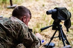 A soldier makes notes on a map after using an H37 Horus to identify hidden targets during target detection training in Smardan, Romania, July 20, 2016. Army photo by Spc. Devone Collins