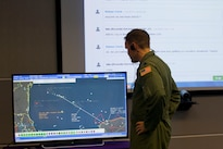 Air Force Lt. Col. Chris Power, the deputy division chief of North American Aerospace Defense Command operations support, takes part in the Amalgam Eagle 16 tactical exercise between the United States and Mexico in Colorado Springs, Colo., July 27, 2016. The three-day exercise was aimed at strengthening information sharing and cooperation in response to a simulation of an illicit cross-border flight. DoD photo by Lisa Ferdinando