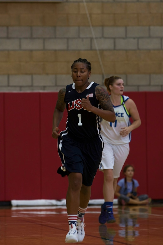 U.S. Army Sgt. Danielle Deberry, a guard on the United States Military Women's Basketball Team, hustles down the court during the United States vs. France game at the Conseil International Du Sport Militaire (CISM) World Military Women's Basketball Championship July 26 at Camp Pendleton, California. The base is hosting the CISM World Military Women's Basketball Championship July 25 through July 29 to promote peace activities and solidarity among military athletes through sports. (U.S. Marine Corps photo by Sgt. Abbey Perria)