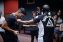 Master Sgt. Samnang Lay, left, and Maj. Tyrone Bess demonstrate self-defense techniques during a Gracie Jiu-Jitsu Defense Systems course at Yokota Air Base, Japan, July 23, 2016. The Gracie Defense Systems is a program specifically designed to increase awareness and reduce the frequency of sexual assaults. (U.S. Air Force photo by Senior Airman Delano Scott/Released)