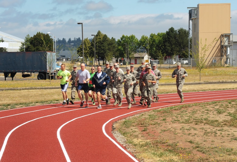 Oregon Air National Guard Col. Paul Fitzgerald, 142nd Fighter Wing commander and Chief Master Sgt. Chris Roper, 142nd Fighter Wing command chief, lead a group of Airmen and base staff during a ceremonial first lap as part of the official opening of the new base track, Portland Air National Guard Base, Ore., July 26, 2016. (U.S. Air National Guard photo by Tech. Sgt. John Hughel, 142nd Fighter Wing Public Affairs/Released)