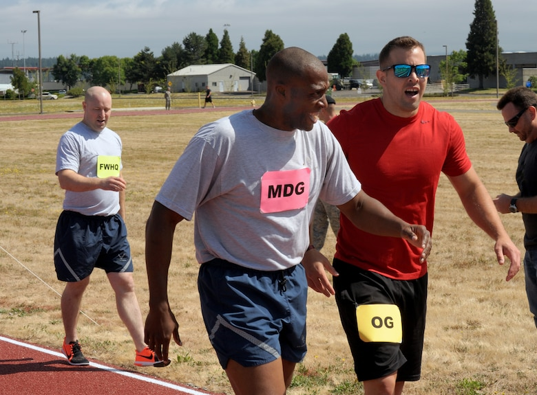 Oregon Air National Guard Tech. Sgt. Justin Comfort, right, and Staff Sgt. Breland Reed,  center, along with Staff Sgt. Andrew Hensley, left, attempt to catch their breath after their quarter mile race held at the new track at the Portland Air National Guard Base, Ore., July 26, 2016. (U.S. Air National Guard photo by Tech. Sgt. John Hughel, 142nd Fighter Wing Public Affairs/Released)
