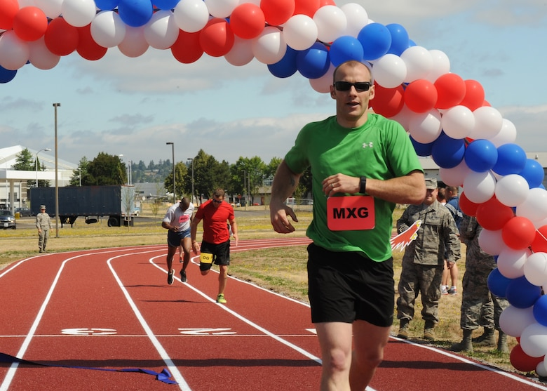 Oregon Air National Guard Staff Sgt. Alan Plank, assigned to the 142nd Fighter Wing Maintenance Group, wins the inaugural first race, followed by Tech. Sgt. Justin Comfort and Staff Sgt. Breland Reed on the new track at the Portland Air National Guard Base, Ore., July 26, 2016. (U.S. Air National Guard photo by Tech. Sgt. John Hughel, 142nd Fighter Wing Public Affairs/Released)