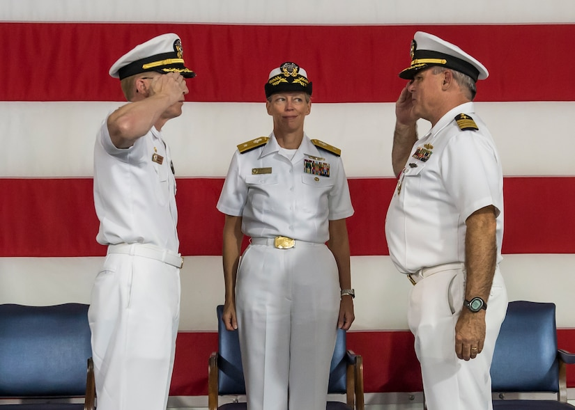 U.S. Navy Capt. Robert Hudson, left, takes command of Naval Support Activity Charleston with a salute to his predecessor Capt. Timothy Sparks. Rear Admiral Mary Jackson, Navy Region Southeast commander, observes during a change of command ceremony, July 21, 2016 aboard the USS Yorktown, Charleston, S.C. Hudson previously served as the Nuclear Power Training Unit Charleston commander. Sparks is retiring after 38 years of military service. (U.S. Air Force photo/Staff Sgt. Jared Trimarchi)
