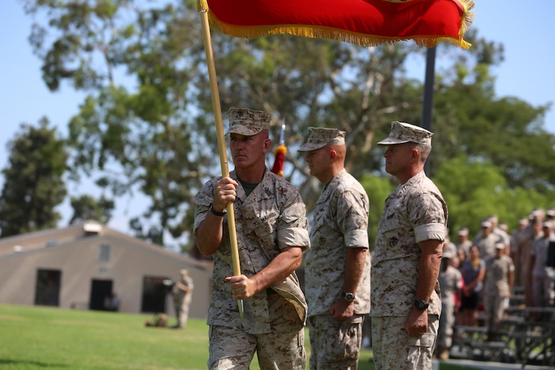 Sgt. Maj. Bradley Kasal, the sergeant major of I Marine Expeditionary Force, marches with the colors during a change of command ceremony at Camp Pendleton July 27, 2016. During the ceremony, Berger relinquished his duties as the commanding general of I MEF to Craparotta. (U.S. Marine Corps photo by Cpl. Garrett White/ RELEASED)