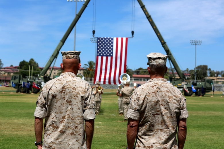 Lt. Gen. Lewis A. Craparotta, the incoming commanding general of I Marine Expeditionary Force and Lt. Gen. David H. Berger, the outgoing commanding general of I MEF, stand at attention during a change of command ceremony at Camp Pendleton July 27, 2016.  During the ceremony, Berger relinquished his duties as the commanding general of I MEF to Craparotta. (U.S. Marine Corps photo by Cpl. Garrett White/ RELEASED)