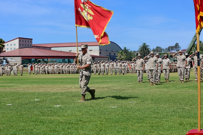 Sgt. Maj. Bradley Kasal, the sergeant major of I Marine Expeditionary Force, marches with the colors during a change of command ceremony at Camp Pendleton July 27, 2016. During the ceremony, Lt. Gen. David H. Berger relinquished his duties as the commanding general of I MEF to Lt. Gen. Lewis Craparotta. (U.S. Marine Corps photo by Cpl. Demetrius Morgan/ RELEASED)