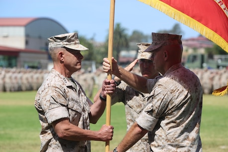 Lt. Gen. David H. Berger, the outgoing commanding general of I Marine Expeditionary Force, passes the unit colors to Lt. Gen. Lewis A. Craparotta during a change of command ceremony at Camp Pendleton July 27, 2016. During the ceremony, Berger relinquished his duties as the commanding general of I MEF to Craparotta. (U.S. Marine Corps photo by Cpl. Demetrius Morgan/ RELEASED)