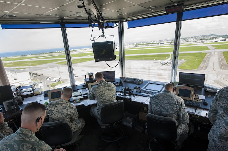 Air traffic controllers from the 18th Operations Support Squadron monitor the flightline for safety risks July 21, 2016, at Kadena Air Base, Japan. Kadena is the largest combat wing in the Pacific. Safety during flightline operations is of the utmost importance for Kadena's air traffic controllers.  (U.S. Air Force photo by Airman 1st Class Lynette M. Rolen)