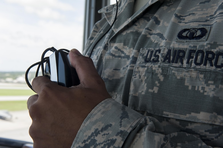 U.S. Air Force Senior Airman Richard Delgado, 18th Operations Support Squadron air traffic controller, speaks with a pilot July 21, 2016, at Kadena Air Base, Japan. Kadena's multiple airframes and many missions require constant communication between pilots and ATC Airmen to operate safely. (U.S. Air Force photo by Airman 1st Class Lynette M. Rolen)