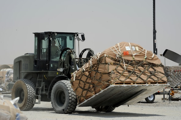 Staff Sgt. Jonathan Parrish, 386th Expeditionary Logistics Readiness Squadron cargo processer, moves a pallet of cargo July 21, 2016 at an undisclosed location in Southwest Asia. In an average week, the 386 ELRS aerial port flight moves about 1500 short tons of cargo. (U.S. Air Force photo/Senior Airman Zachary Kee)