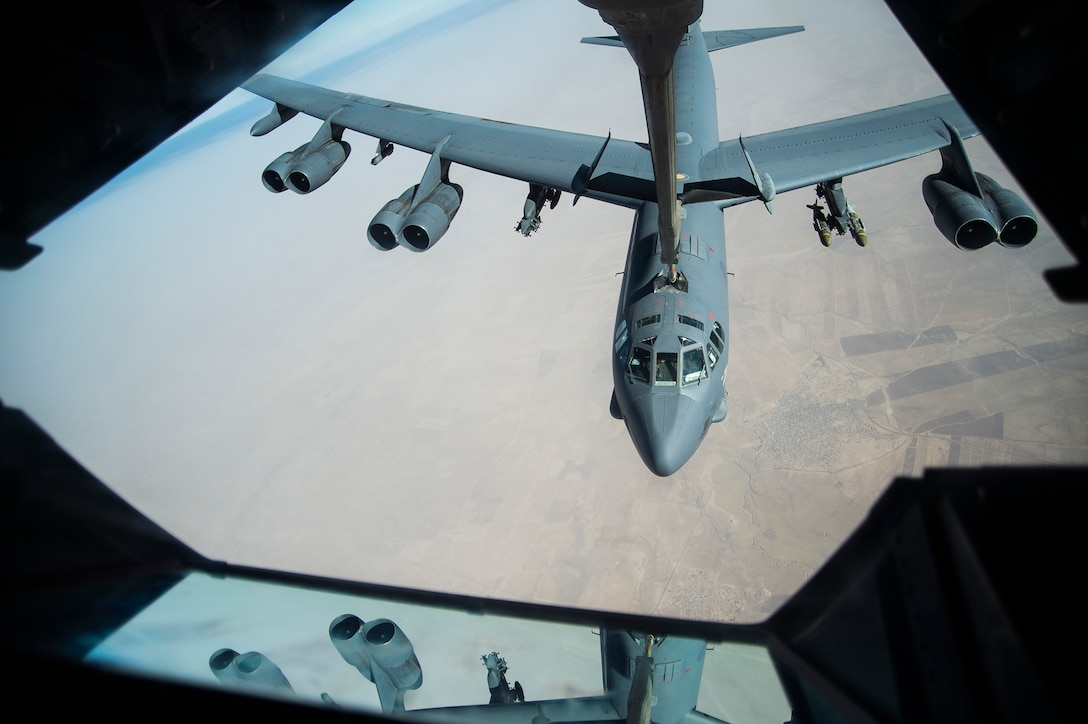 A B-52 Stratofortress receives fuel from a KC-10 Extender over Iraq, July 16, 2016. Airmen from the 908th Expeditionary Air Refueling Squadron refueled F-15 Strike Eagles, Belgian Air Force F-18 Super Hornets, a B-52 Stratofortress and F-16 Fighting Falcons support of Combined Joint Task Force-Operation Inherent Resolve. The U.S. and more than 60 coalition partners work together to eliminate the terrorist group ISIL and the threat they pose to Iraq and Syria. (U.S. Air Force photo/Staff Sgt. Larry E. Reid Jr., Released)