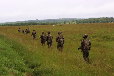U.S. Marines with Bravo company, 1st Battalion, 8th Marine Regiment, Special Purpose Marine Air-Ground Task Force-Crisis Response-Africa search for simulated enemy during a Non-combatant evacuation operation exercise hosted by French Army Center for Urban Combat Training instructors aboard Camp Sissonne, France, June 21, 2016. SPMAGTF-CR-AF Marines trained alongside a company of French Army soldiers, integrating their skills and resources to form an effective battle plan, similar to what they may face in the event of a future crisis. (U.S. Marine Corps photo by Sgt. Kassie L. McDole/Released)