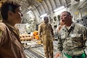 Capt. Mark Burkard, 379th Enroute Patient Staging Facility registered nurse, talks with a member of the aeromedical evacuation team about the patients loaded onto a C-17 Globemaster III July 18, 2016, at Al Udeid Air Base, Qatar.  The patients were enroute to Landstuhl Regional Medical Center Germany for a higher level of care. (U.S. Air Force photo/Technical Sgt. Carlos J. Treviño)