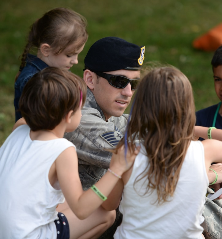 Team Mildenhall children, parents and Airmen take part in outdoor games during Vacation Bible School July 25, 2016, on RAF Mildenhall, England. This annual event is open to all military members and their families from RAF Mildenhall or RAF Lakenheath. (U.S. Air Force photo by Gina Randall)