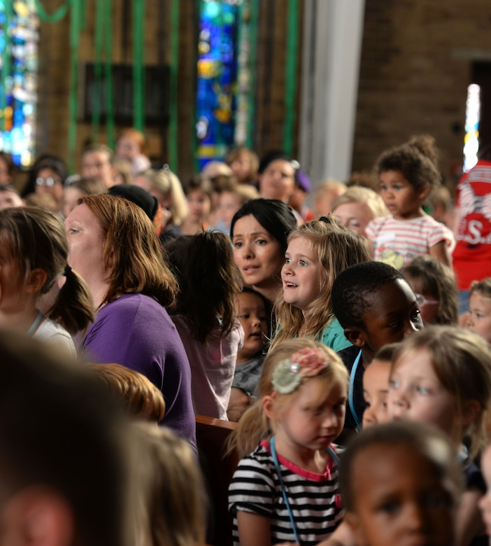 Team Mildenhall children and parents take part in Vacation Bible School July 25, 2016, in the chapel on RAF Mildenhall, England. The chapel hosts this event annually to bring families together. (U.S. Air Force photo by Gina Randall)