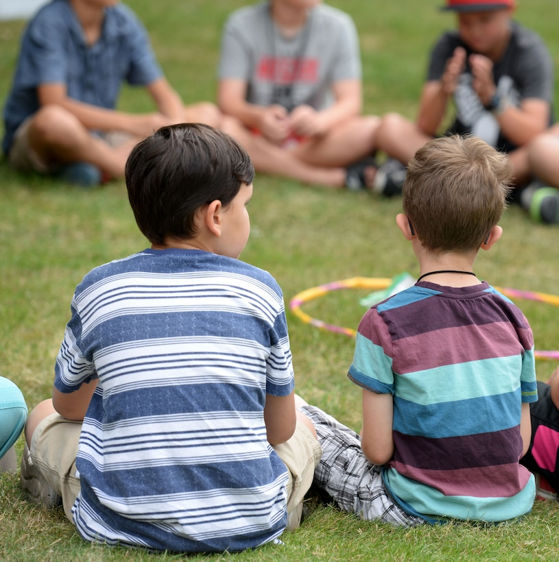 Team Mildenhall children take part in outdoor games during Vacation Bible School July 25, 2016, on RAF Mildenhall, England. The children played team-building games to inspire teamwork and cooperation. (U.S. Air Force photo by Gina Randall)