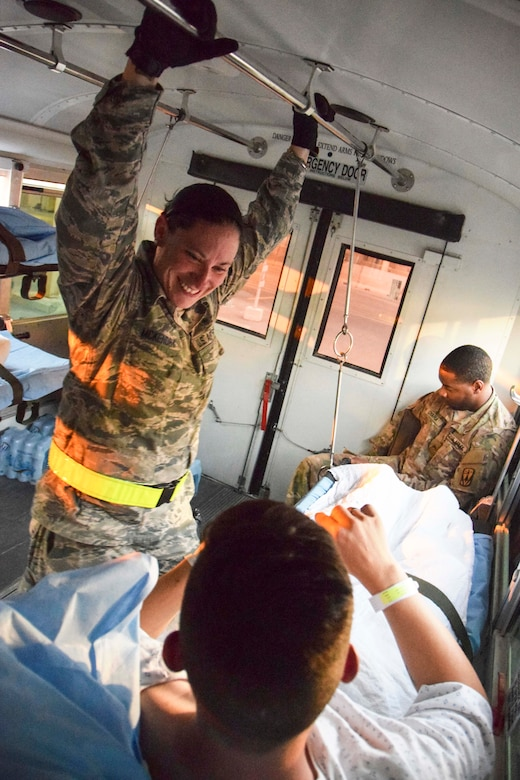 Staff Sgt. Jennifer McKendry, 379th Expeditionary Medical Group Enroute Patient Staging Facility medical technician, supports a patient during transport July 18, 2016, at Al Udeid Air Base, Qatar.  The patient was one of 14 military members flown on a C-17 Globemaster III to Landstuhl Regional Medical Center, Germany, to receive a higher level of care than what is routinely available at deployed locations. (U.S. Air Force photo/Technical Sgt. Carlos J. Treviño)