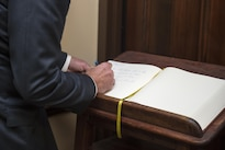 Defense Secretary Ash Carter signs the guest book at the XVIII Airborne Corps headquarters during a visit to Fort Bragg, N.C., July 27, 2016. DoD photo by Air Force Tech. Sgt. Brigitte N. Brantley