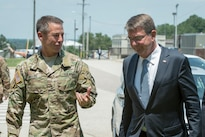 Defense Secretary Ash Carter, right, talks with Army Lt. Gen. Austin Miller, commander of Joint Special Operations Command, during a visit to Fort Bragg, N.C., July 27, 2016. DoD photo by Air Force Tech. Sgt. Brigitte N. Brantley