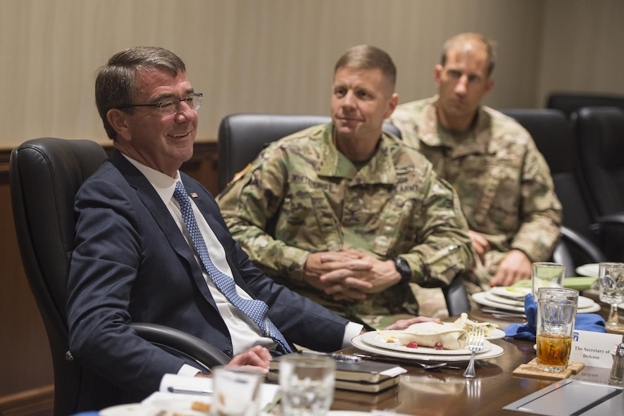 Defense Secretary Ash Carter, left, meets with deploying soldiers.