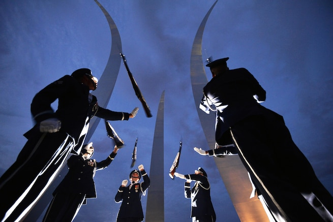 Airmen toss their rifles in the air while participating in ceremonial drill training at the Air Force Memorial in Arlington, Va., July 26, 2016. Air National Guard photo by Staff Sergeant Christopher S. Muncy