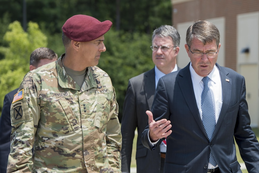 Defense Secretary Ash Carter speaks with Army Lt. Gen. Stephen Townsend, left, commanding general of the XVIII Airborne Corps.