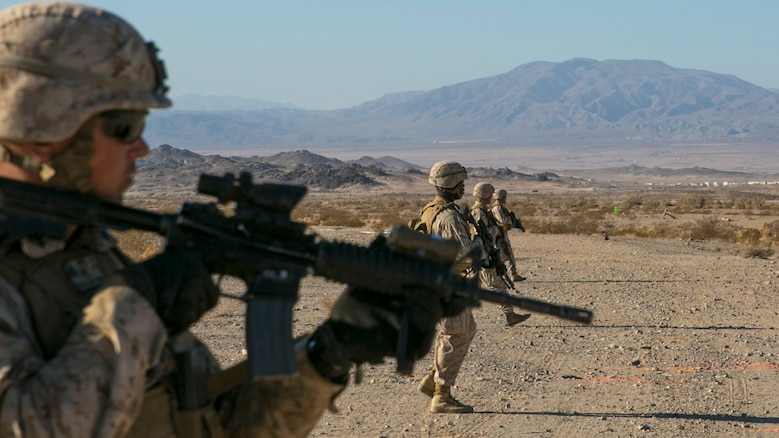 "Marines with 3rd Battalion, 4th Marine Regiment, proceed in a skirmisher formation at the beginning of a live-fire exercise as part of Tactical Small-Unit Leadership Course at Marine Corps Air Ground Combat Center, Twentynine Palms, California, July 18, 2016. The purpose of the course was to focus on the training of small-unit leadership within ""Darkside."""