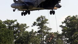 A Marine with U.S. Marine Corps Forces Special Operations Command rappels off the ramp of a CH-53E Super Stallion with Marine Heavy Helicopter Squadron 461 on Landing Zone Parrot at Marine Corps Base Camp Lejeune, N.C., July 20, 2016. The exercise was a part of a two weeklong Helicopter Insertion and Extraction Techniques Course. The CH-53 provided for the training evolution was assigned to Marine Heavy Helicopter Squadron 461, 2nd Marine Aircraft Wing.