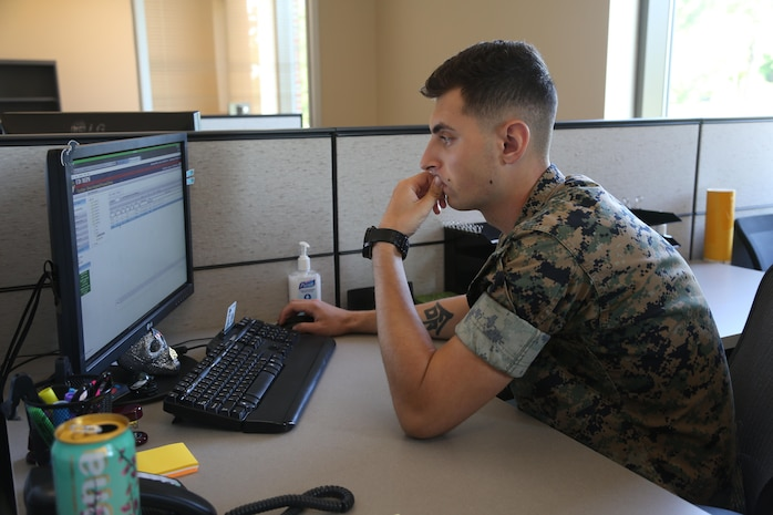 Cpl. Vyacheslav Rakhminov, an administrative specialist with Headquarters and Headquarters Squadron, works at the new installation personnel administration center on Marine Corps Air Station New River July 20. Before moving into the new building on July 18th, IPAC was worked in two separate buildings. The new 17,000 square foot building serves as a centralized location for Marines stationed at the air station. (U.S. Marine Corps photo by Cpl. Mark Watola /Released)