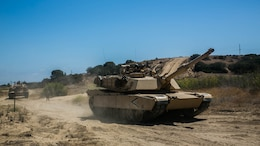 Marines with Company A., 4th Tank Battalion, 4th Marine Division, Marine Forces Reserve, return from patrolling in M1A1 Abrams Main Battle Tanks during their annual training at Marine Corps Base Camp Pendleton, Calif., July 17, 2016. The annual training exercise displayed the Marines ability to execute heavily armored, large scale attacks while working with their active duty counterparts.