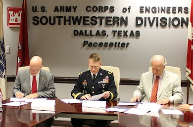 From left, Jeff Walker, Executive Administrator for the Texas Water Development Board; Brig. Gen. David C. Hill, Commander of the Southwestern Division, U.S. Army Corps of Engineers; and Ron Curry, Regional Administrator, Environmental Protection Agency Region 6; sign a Partnering Agreement in Dallas to improve intra-agency coordination for large Texas water supply projects.