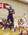 Army Sgt. Creshenda Singletary of Fort Bragg, N.C., hooks it over a French defender during Team USA's 85-53 win over France at the Conseil International du Sport Militaire Women's Basketball Championship tournament at Marine Corps Base Camp Pendleton, Calif., July 26, 2016. Army photo by Gary Sheftick