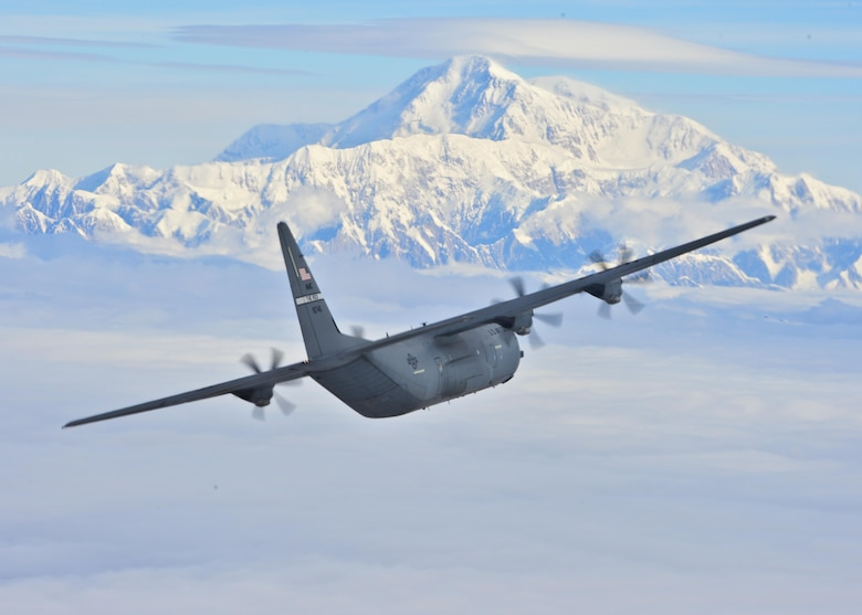 A C-130J Super Hercules from the 41st Airlift Squadron flies past Denali, the highest peak in North America, July 19, 2016. The 41st AS conducted training in Alaska to prepare for the terrain present in austere locations. Alaska provides an uncontended airspace, which allows aircrews to train more effectively without having to adjust to commercial flight patterns. (U.S. Air Force photo/Senior Airman Kaylee Clark)