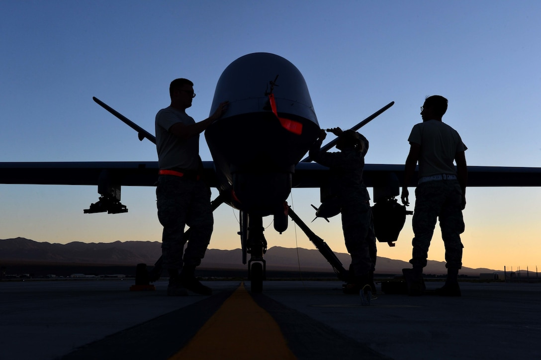 Airmen from the 432nd Aircraft Maintenance Squadron perform maintenance on an MQ-9 Reaper in preparation to support Red Flag 16-3 at Creech Air Force Base, Nev., July 20, 2016. The exercise also incorporated aircraft platforms from U.S. military services and coalition partners in a variety of training scenarios. (U.S. Air Force photo/Airman 1st Class Kristan Campbell)