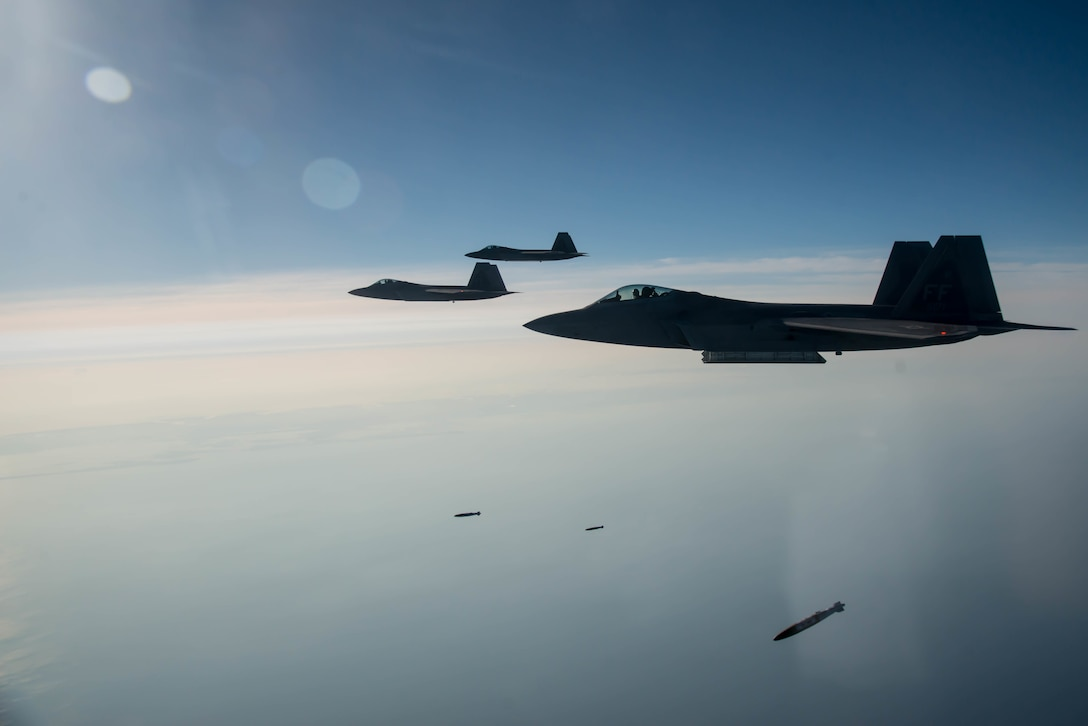 F-22A Raptors with the 94th Fighter Squadron drop joint direct attack munitions during the 95th anniversary of when Gen. William Billy Mitchell bombed the Ostfriesland, a captured German warship, at Langley Air Force Base, Va., July 21, 2016. Mitchell and the 1st Provisional Air Brigade demonstrated to the world the superiority of airpower by sinking the reputedly unsinkable Ostfriesland. (U.S. Air Force photo/Staff Sgt. J.D. Strong II)