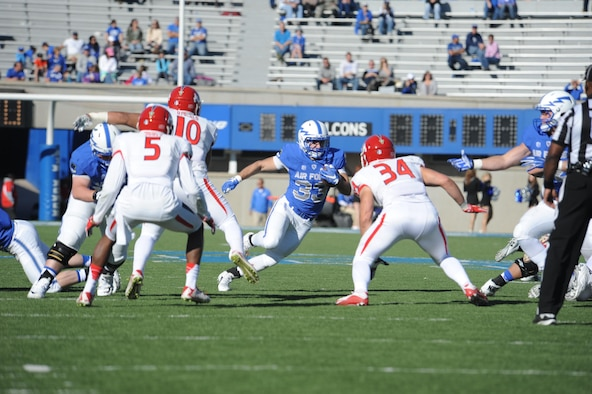 Junior running back Tim McVey makes a cut to avoid defenders in the Air Force-Fresno State game on Oct. 24, 2015. McVey emerged last season as a multi-dimensional threat, finishing third on the team in rushing and fourth in receiving, and racked up 887 all-purpose yards. In his first career start, he became the first player in Air Force history to have 100 yards rushing and receiving in the same game. (U.S. Air Force photo/John Van Winkle)