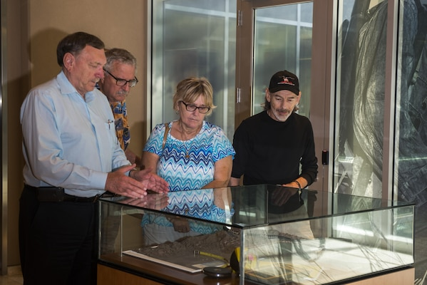Family and friends of a World War II prisoner of war visit the Defense POW/MIA Accounting Agency (DPAA) for a tour of the facility, June 30. The mission of DPAA is to provide the fullest possible accounting for our missing personnel to their families and the nation