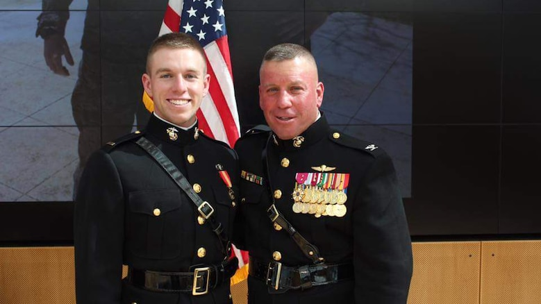 Second Lieutenant David Higgins, (left) poses for a photo with his father, Col. David A. Higgins at his commissioning ceremony on June 2, 2016. Lieutenant Higgins shoots rifle professionally, and will be representing not only Team USA, but also the United States Marine Corps in the 2016 Summer Olympics in Rio De Janeiro. Colonel Higgins is the G-3 Deputy of I Marine Expeditionary Force.