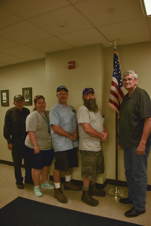 George Kelly, vehicle maintenance manager, stands with friends during his retirement party at the Pittsburgh International Air Reserve Station, Pennsylvania, July 26, 2016. Kelly's future plans include relaxing and traveling the country. (U.S. Air Force courtesy photo by Ashley Podrasky)