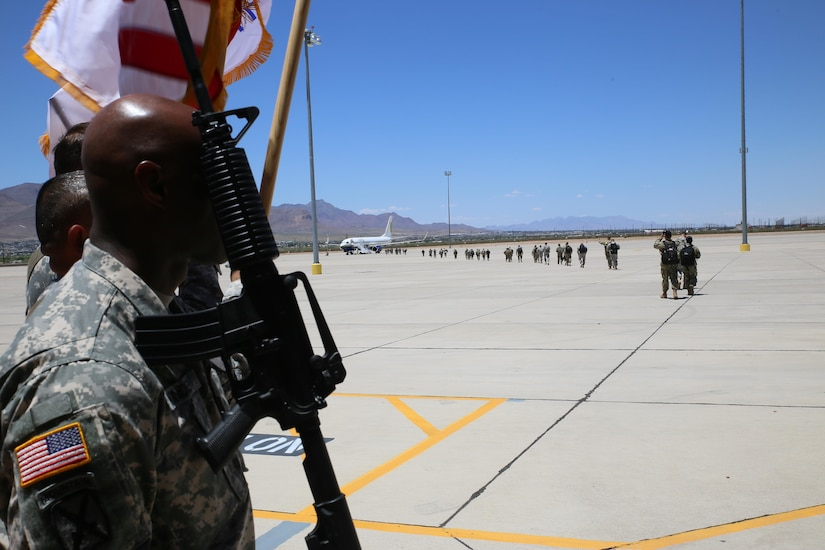 Soldiers assigned to the 544th Military Police Company, Puerto Rico Army National Guard, board a flight for a nine month deployment to Honduras July 11.