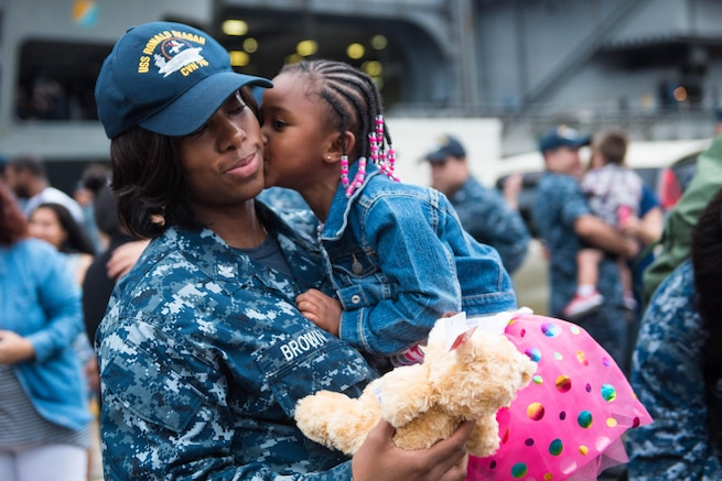 Navy Petty Officer 1st Class Donisha Brown reunites with her daughter during a homecoming celebration for the USS Ronald Reagan at Fleet Activities Yokosuka, Japan, July 26, 2016.The aircraft carrier participated in 53 days of strike group operations. Navy photo by Petty Officer 3rd Class James Lee