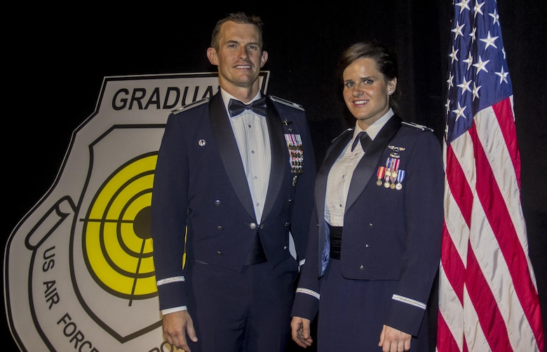 Lt. Col. Scott Mills, U.S. Air Force Weapons School, 66th Weapons Squadron commander and Capt. Jessica Wyble, 66th WPS A-10 Thunderbolt II pilot, pose at the USAFWS graduation ceremony, Las Vegas, June 25, 2016. Wyble is the first woman to successfully complete the USAFWS graduate-level A-10 weapons instructor course that provides the world's most advanced training in weapons and tactics employment (U.S. Air Force photo by Susan Garcia/Released)