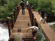 Cadets and Academy staff teamed up with the U.S. Forest Service for the design and installation of a pedestrian trail bridge in the Maroon Bells–Snowmass Wilderness in the White River National Forest. (Courtesy photo)