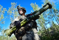 Army Spc. Sixto Carrasquiollo holds an AT-4 anti-armor weapon before moving out to check on an occupied defensive position during a coordinated opposing forces attack as part of Arctic Anvil 2016 in Donnelly Training Area near Fort Greely, Alaska, July 25, 2016. Carrasquiollo is assigned to the 25th Infantry Division's Company A, 1st Battalion, 24th Infantry Regiment, 1st Stryker Brigade Combat Team, Alaska. Air Force photo by Justin Connaher