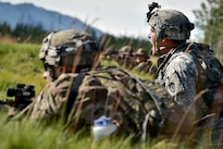 Army 1st Sgt. Brett Graves, right, yells commands to his soldiers to fire upon an enemy sniper team during a coordinated opposing forces attack as part of Arctic Anvil 2016 near Fort Greely, Alaska, July 25, 2016. Graves is assigned to the 25th Infantry Division's Company A, 1st Battalion, 24th Infantry Regiment, 1st Stryker Brigade Combat Team, Alaska. Air Force photo by Justin Connaher